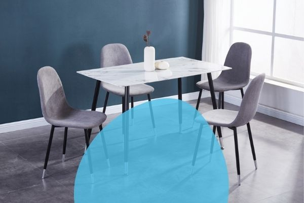 Image depicts a dinette from Dani's Furniture, with a marble table and four modern dining chairs.