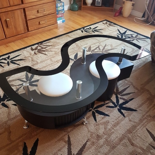 Image depicts a glass coffee table.