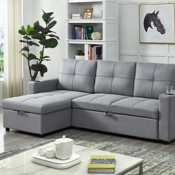 Image depicts a grey sofa sectional in a living room.
