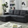 Image depicts The Harper Sofa Bed Sectional which comes with a storage compartment inside the chaise and two cup holders.