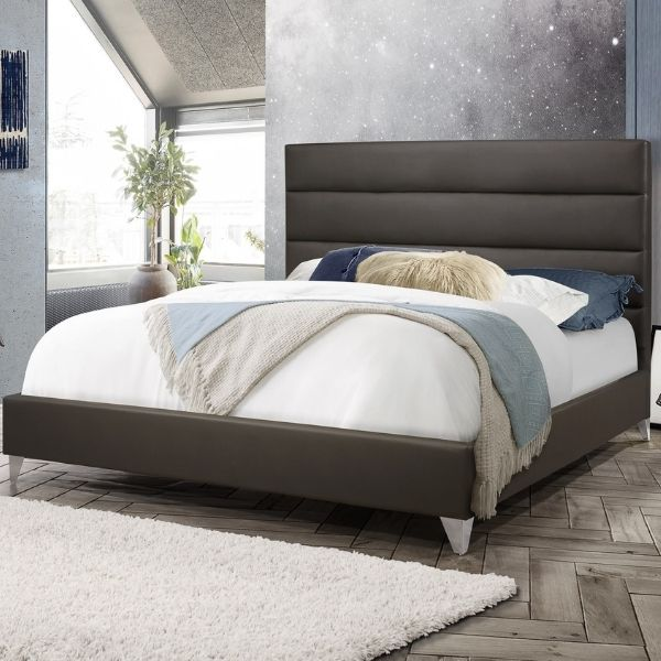Image depicts a modern platform bed with a brown headboard.