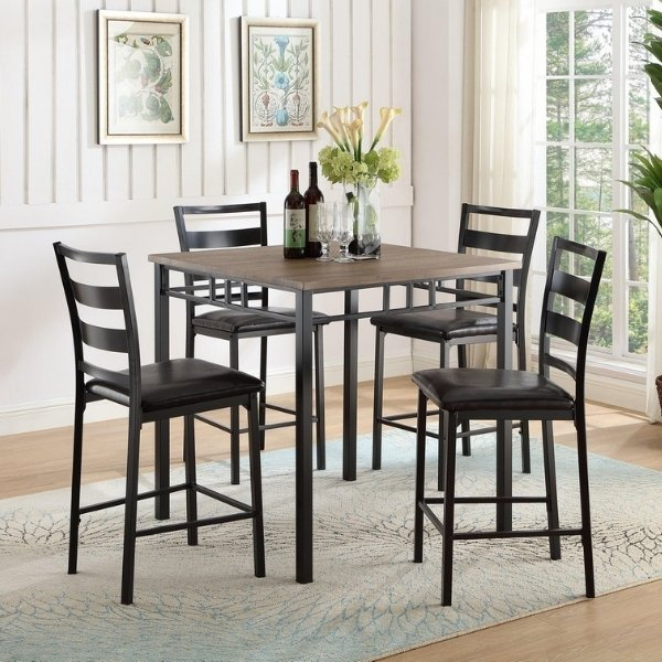 Image depicts a dining set with a high wood-top table and high stools.