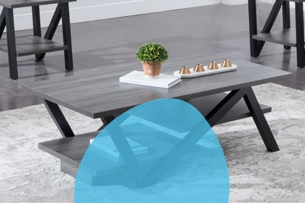 Image depicts a wood coffee table sitting in a living room.