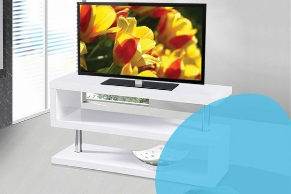 Image depicts a modern white TV stand in a living room.