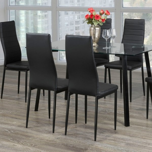 Image depicts a 7-piece dining set, in a Saint John home, which includes a table and six chairs.
