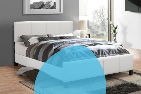 Image depicts a modern bed in a bedroom.