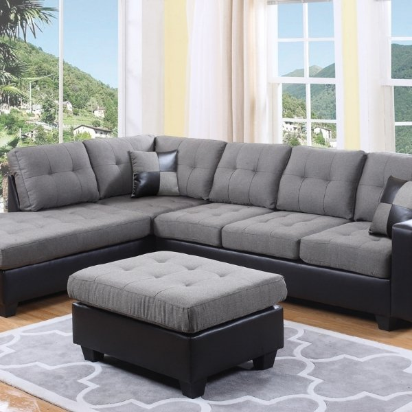 Image depicts a large grey sectional sofa from Dani's Furniture.