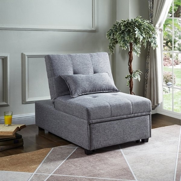 Image depicts a light grey transformable sofa bed from Dani's Furniture.
